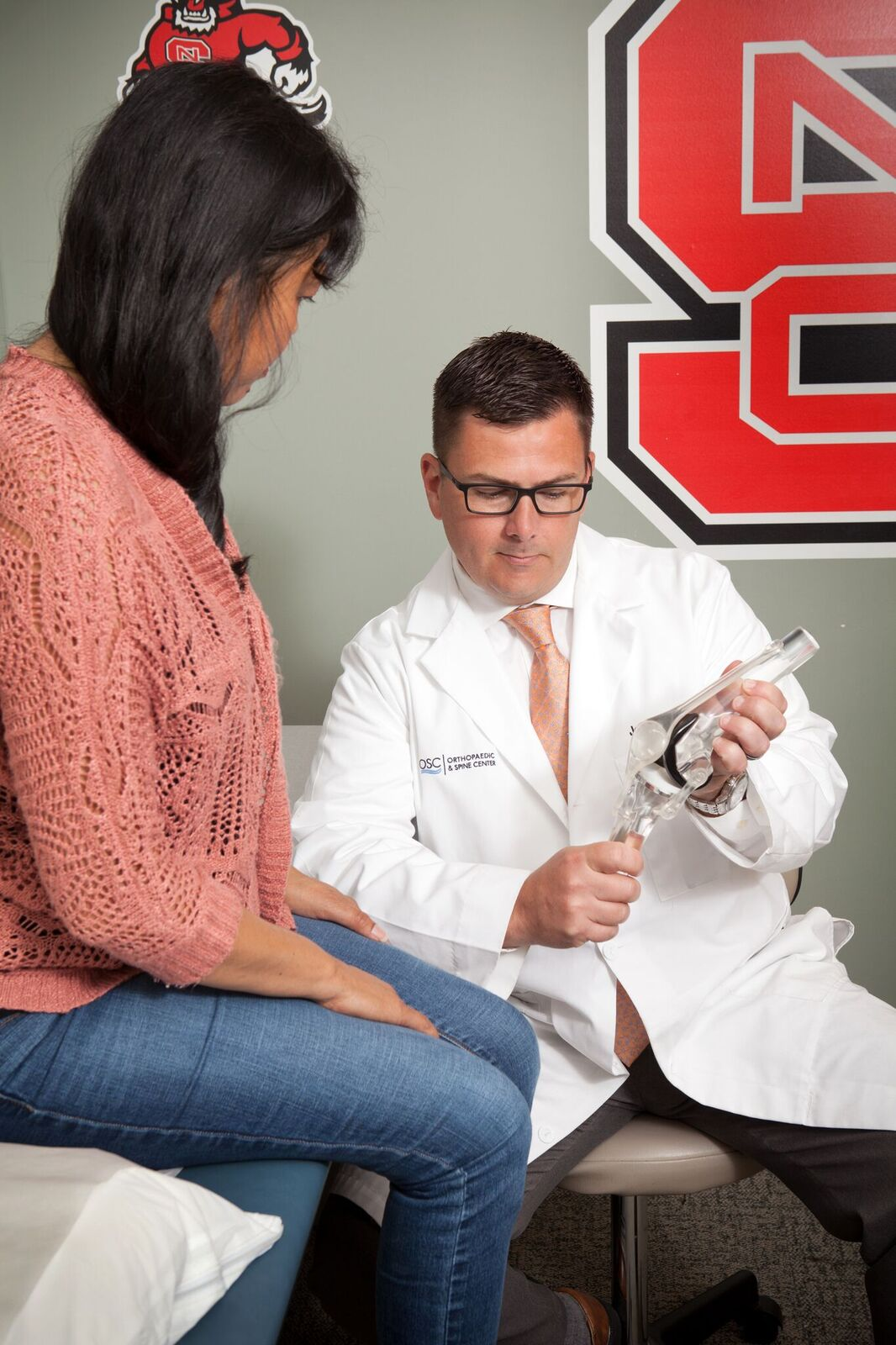 Dr. Burrow demonstrating the knee to a patient